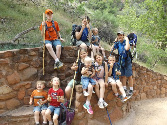 The kids having a snack on the trail at Zion.