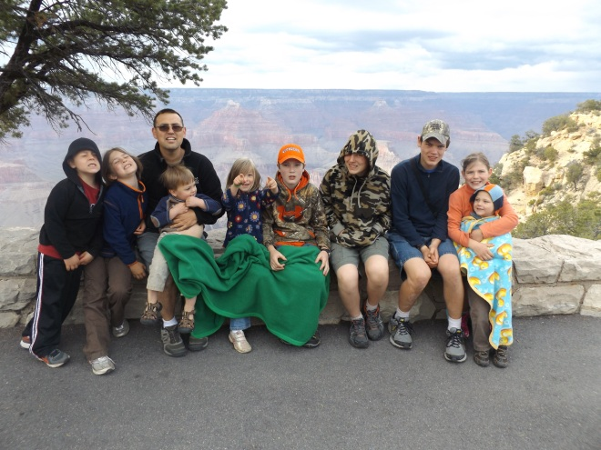 Charlie and the kids at an overlook of the Grand Canyon.