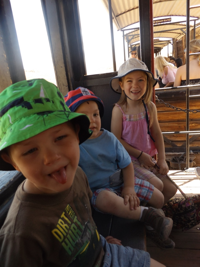 Dominic, Damien, and Amelia on the train in Calico.