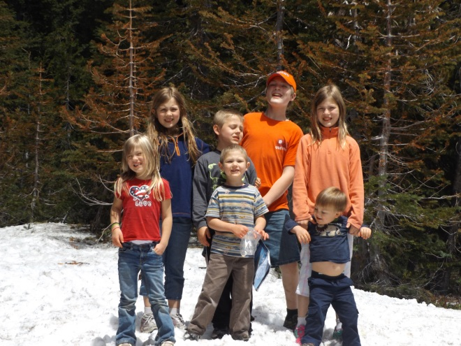 The kids enjoying some of the snow at Crater Lake.