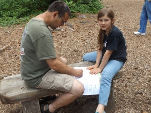 Charlie helping Annette with the Jr. Ranger program.