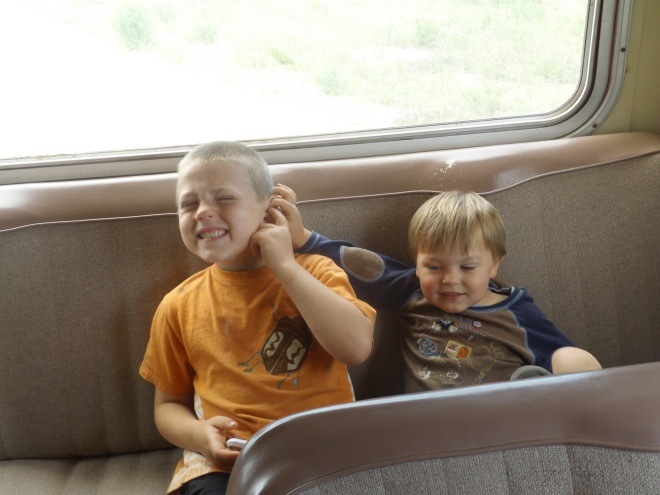 Isaac and Damien on the bus (pinching has been Damien's favorite pastime on this trip!)