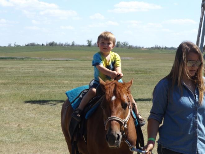 Damien on horseback.