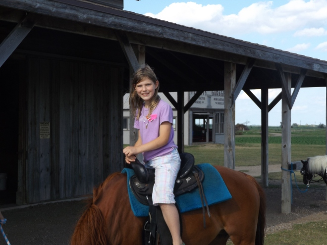 Alex on horseback.